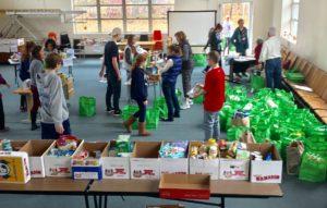 Volunteers help check expiration dates, sort, and shelve food.
